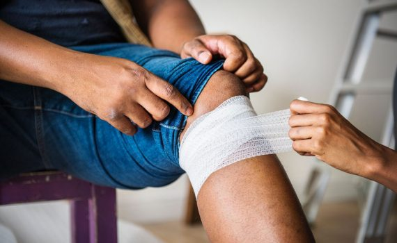 Man having his wound treated and bandaged to prevent scars