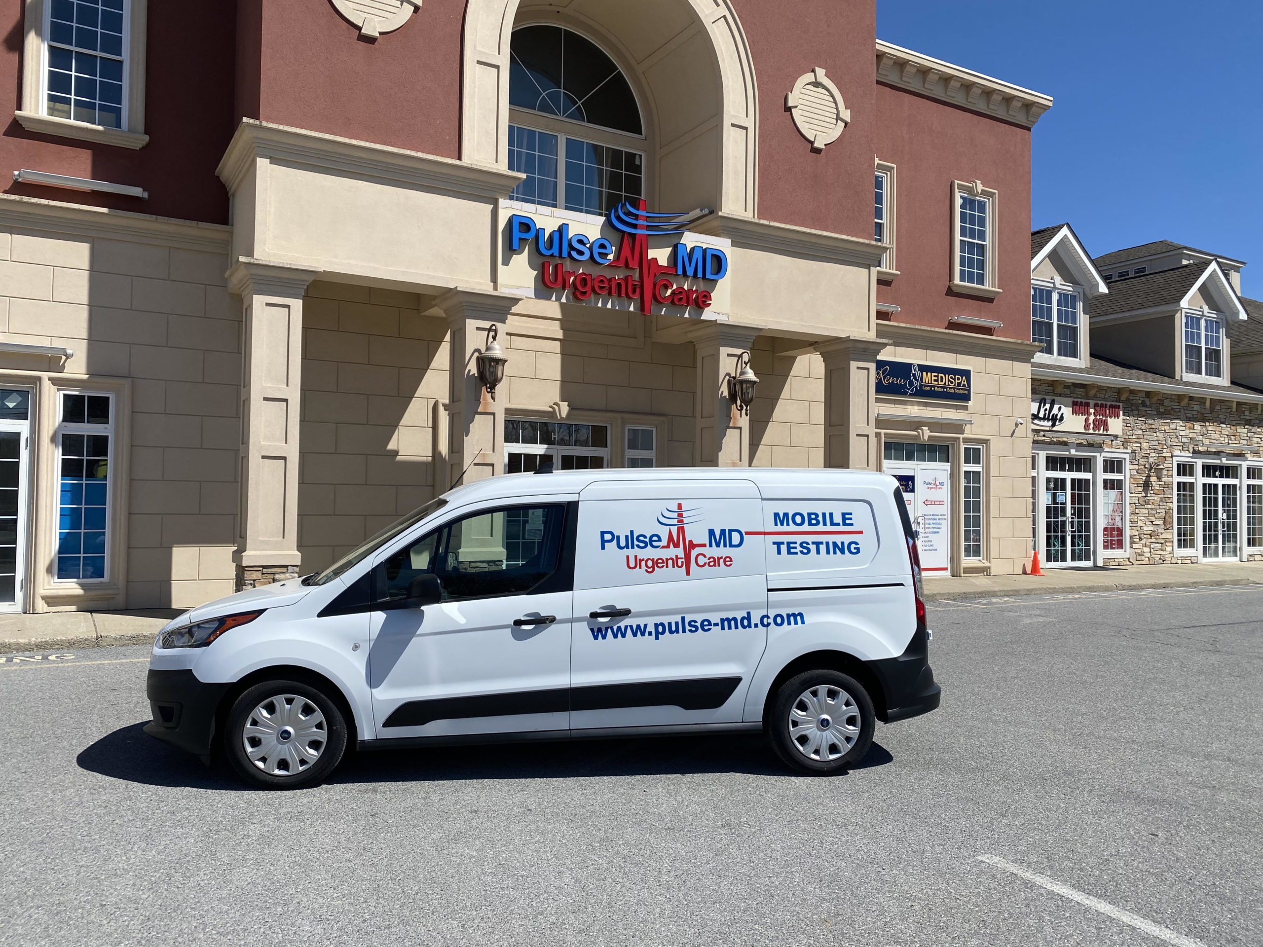 pulse-md mobile covid-19 testing van in front of pulse-md wappinger falls urgent care clinic